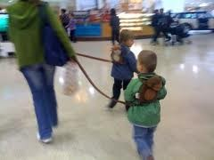 walking through the airport with a 2 in 1 harness buddy
